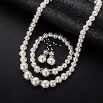 Smyckeset med Vita Pärlor och i  925 Sterling Silverplätering