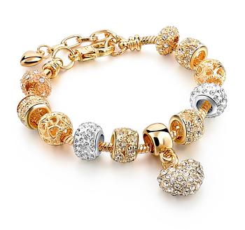"""Armband """"Heart Charm"""" med Austrian Crystals och i 18 K Ros Guldplätering"""