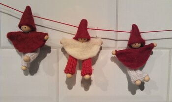 Little santas on a rope through the hood