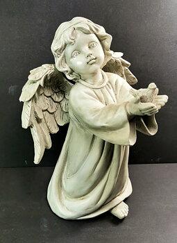 Ängel med fågel i händer