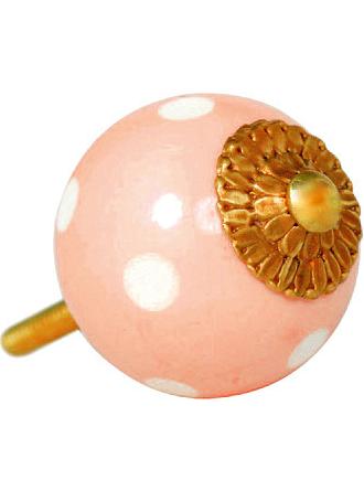 Rosa knopp med vita prickar