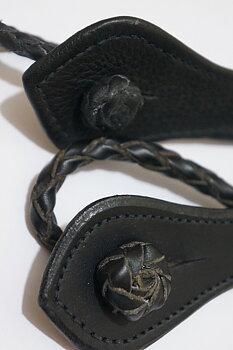 Deuber & Partner stigbygelhållare, flätad, par, svart (2:a sort.)