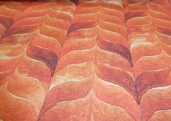 Fantasimönster i varm orange toner
