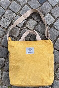 Axelremsväska i vintagestil, gul finribbad manchester.