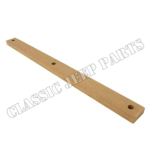 Wood spacer driver seat to rear floor fuel tank shield