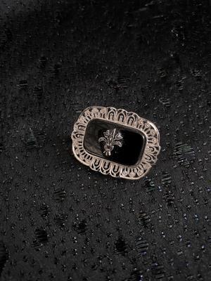 Silverbrosch  med svart onyx och Markasiter.