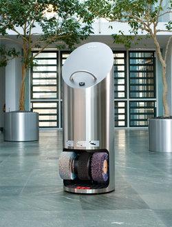 Ellipse shoe shine machine