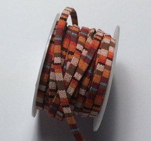 Vävt textilband i bo-ho stil, 5 mm bredd. Per 50 cm.