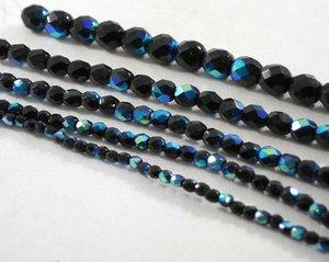 Fasetterade svarta fire polish med AB lyster , 3 mm. En sträng.