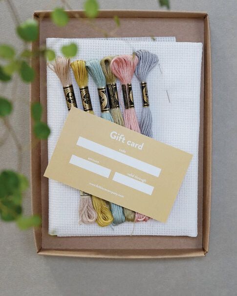 Start kit including tote bag, soluble canvas, floss, needle and a gift card.