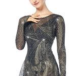 Långärmad guldglittrande klänning