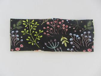 Pannband Blommor på svart