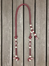 Headstall with knot adjustment and decorative knots