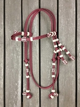 Rope bridle with knot adjustment and decorative knots