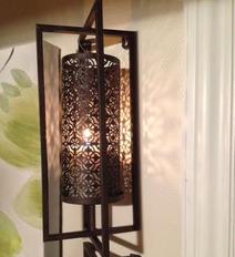 Lampett, vägg i svart smide