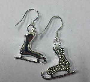 Silverörhängen skridskor hängande
