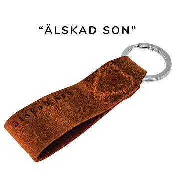 """Exklusiv nyckelring med text """"älskad son"""", läder"""