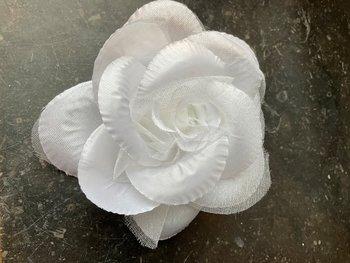 Blomma med snodd