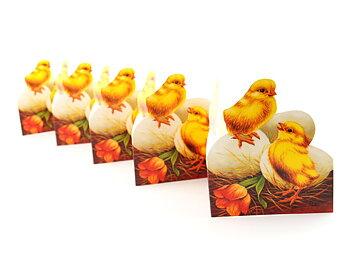 Pappersrader, kyckling på ägg