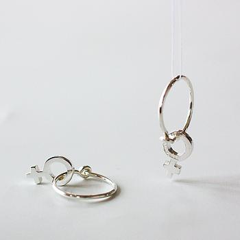 Kompass - litet venustecken i silver eller 18 karat