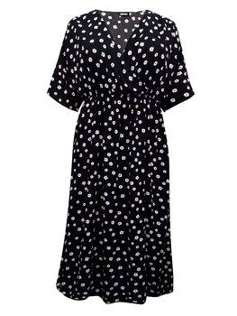 Klänning med omlottringning, tusenskönor på svart botten