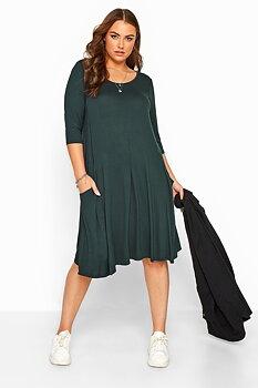 Klänning i swingmodell med fickor, grön