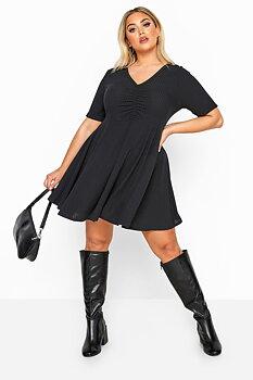 Klänning i ribbat tyg, svart