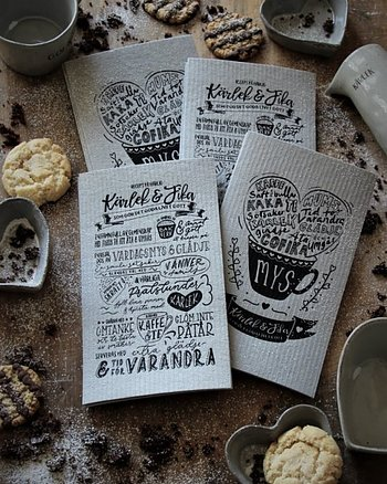 Dish cloth in gray with a black art print of the Love & Coffee recipe