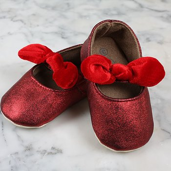 Red shoes with plush bow baby