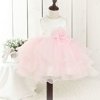 Princess dress with fluffy pink organza skirt and pearls