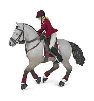 Tävlingsryttare med häst dam