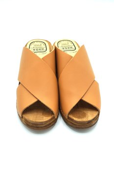 A clog with leather crossed over -Cognac